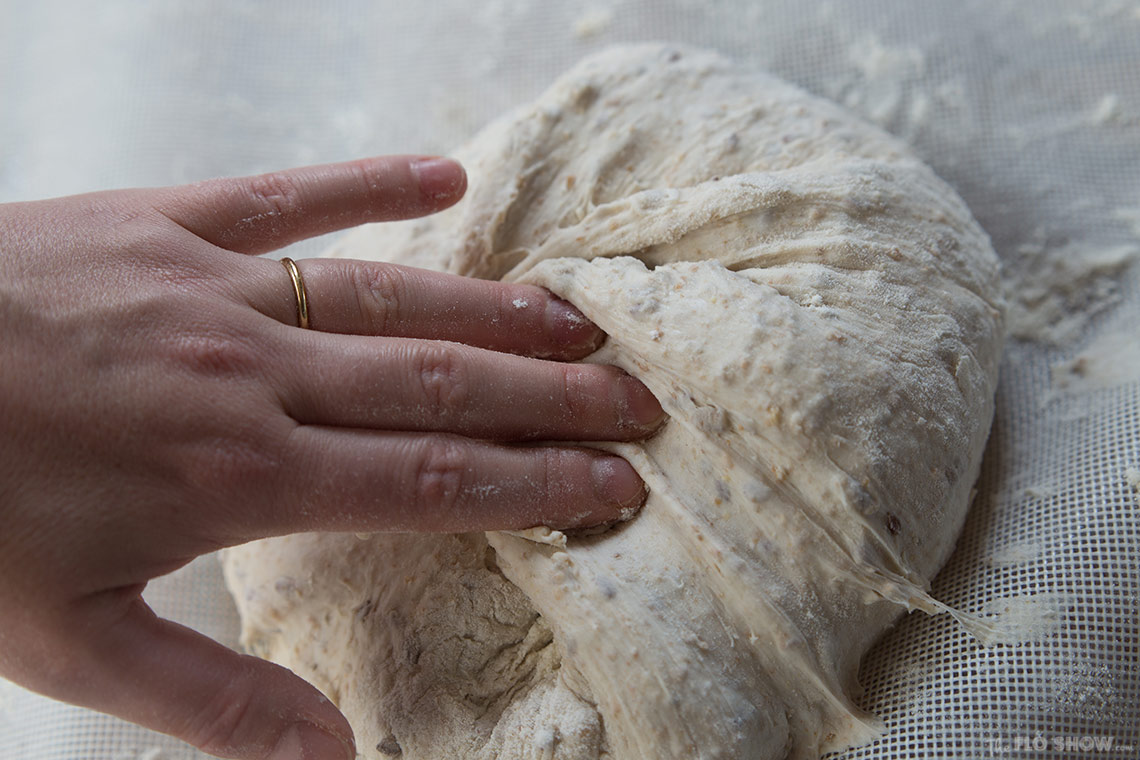 How to make your first home-made sour-dough bread from scratch - the secrets of folding the dough on www.TheFloShow.com