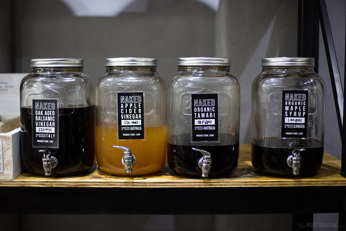 Store review - Naked Food in Newtown - a collection of vinegar in bulk on www.TheFloShow.com