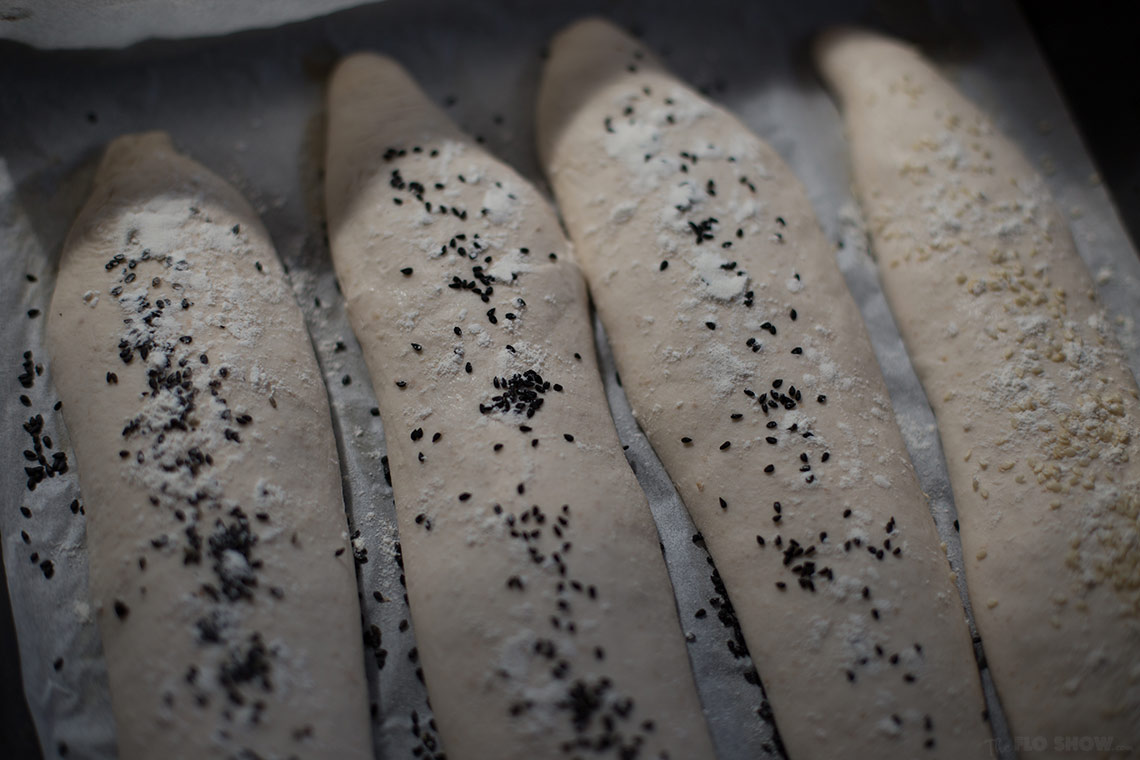French sour-dough baguette recipe - crispy crust and airy inside and sprinkled with seeds on TheFloShow.com